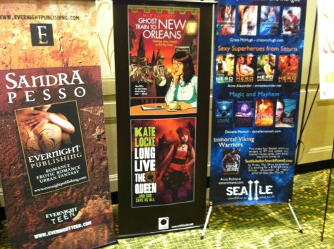 Freestanding lobby posters for contemporary and urban fantasy romance imprints.