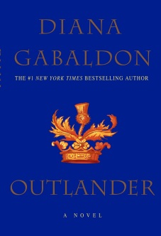 Book cover: Outlander. A blue cover with gold lettering and thistle emblem.